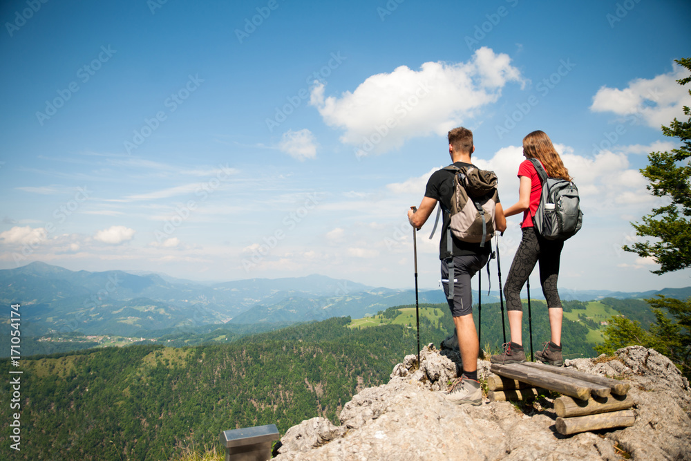 Fototapety, obrazy: active Beautiful young couple hiking ina nature climbing hill or mountain - man and woman trekking