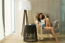 Woman Sitting In Rocking Chair