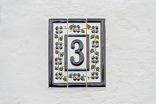 Number Three On White Wall