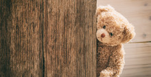Teddy Bear On Wooden Background