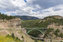 Cars Driving Over Big Bridge Through A Mountain Pass