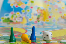Blue, Yellow And Green Plastic Chips, Dice And Board Games For Children .  Selective Focus