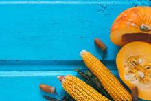 Corns And Pumpkin On Blue Wood...