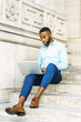 Young African American graduate student with beard studying in New York