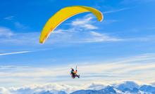 Paragliding Over The Mountains In Winter. Ski Resort  Hopfgarten, Tyrol, Austria
