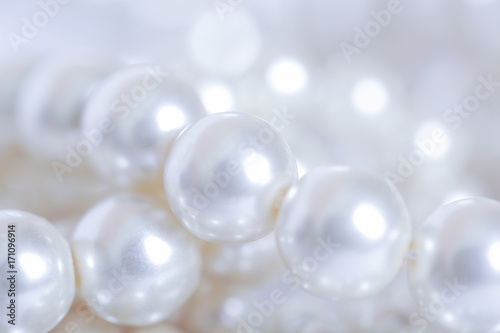 Pile of pearls on the white background