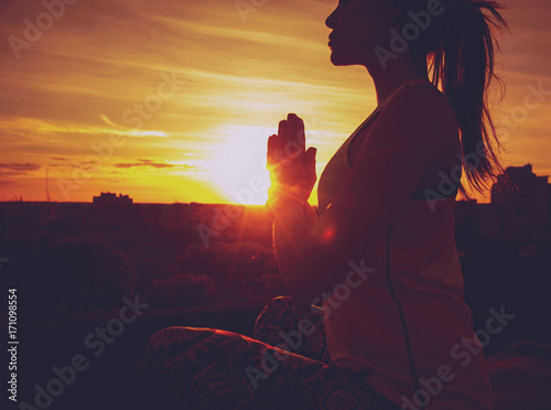 Printed kitchen splashbacks Brown Young girl yoga on the roof. Silhouette
