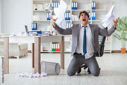 Fotografía  Angry businessman shocked working in the office fired sacked