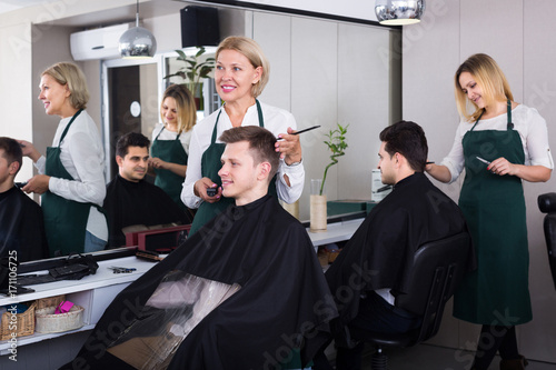 Fototapety, obrazy: hairdresser cutting hair of male