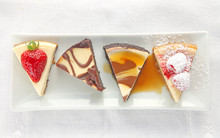 Four Cheesecake Portions Toppe...