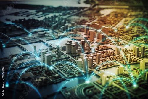 Fotografie, Obraz  Miniature model city and communication network concept