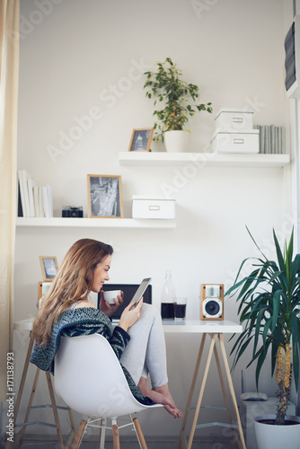Student drinking coffee and using tablet in the morning Poster