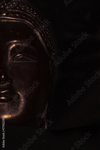 Tuinposter Boeddha buddha statue face lines highlighted on black background