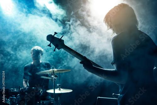 Valokuva A drummer and bass guitarist.