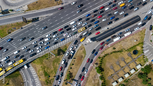Fotografie, Obraz  Aerial top view of road junction from above, automobile traffic and jam of many