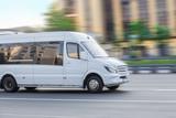 Fototapeta Miasto - minibus goes on the city street