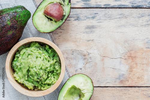 Avocado on wooden floor.