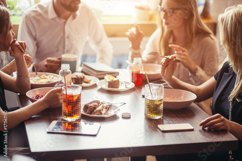 Group Enjoying Business Lunch In Delicatessen Canvas Print