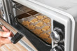 Baking tray with Christmas raw cookies on oven