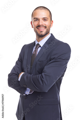 Fotografie, Obraz  Portrait of handsome smiling business man with arms crossed, isolated on a white