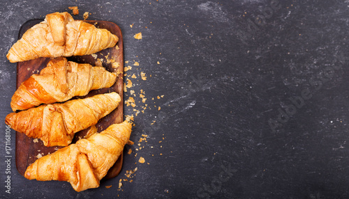 fresh croissants on a wooden board