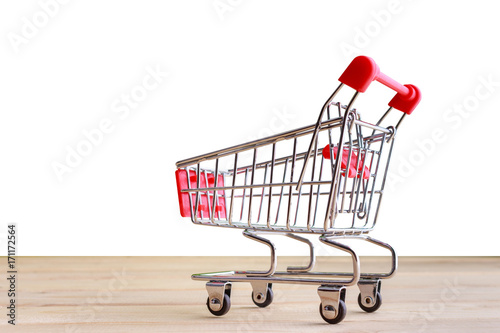Shopping Cart isolated on wood and white background.
