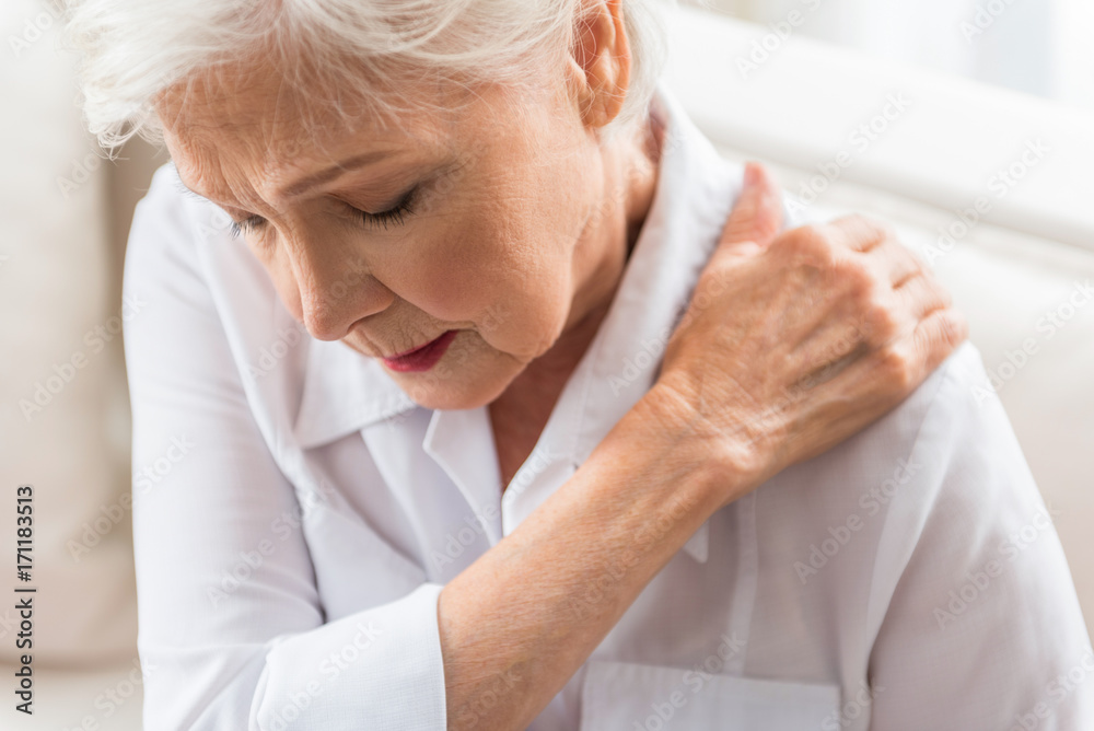 Fototapety, obrazy: Senior lady is demonstrating suffering from ache
