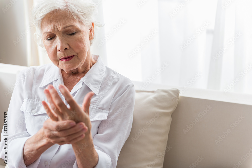 Fototapety, obrazy: Elderly lady is enduring strong ache