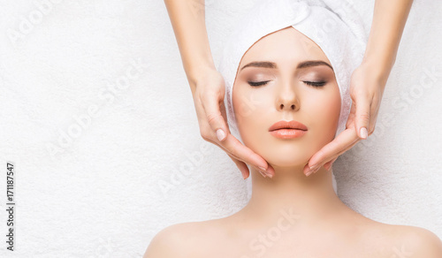 Fotobehang Spa Woman getting face massage treatment. Person in spa. Healthcare, healing, and medicine concept.