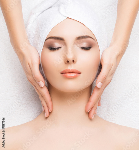 Foto op Plexiglas Spa Woman getting face massage treatment. Person in spa. Healthcare, healing, and medicine concept.