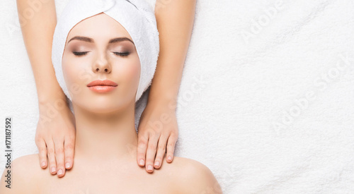 Foto op Plexiglas Spa Portrait of a woman in spa. Massage healing procedure. Health care, skin lifting and medical concept.
