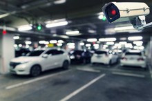 CCTV, Security Indoor Camera System Operating With Blurred Image Of Under Ground Indoor Car Parking Garage Area, RFID Solution Management System, Surveillance Security And Safety Technology Concept