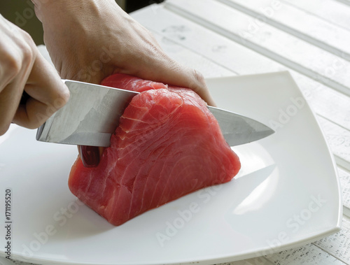 Yellow Fin Tuna being cut up for cooking. Tuna Fish. Canvas Print