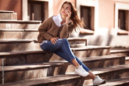Young and beautiful woman in casual clothes in the street. Autumn fashion concept.