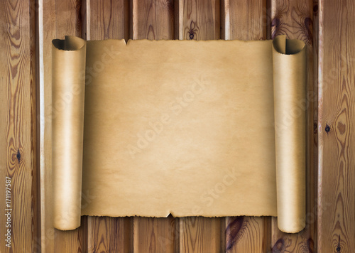 Photo  Old vintage parchment scroll on wooden background