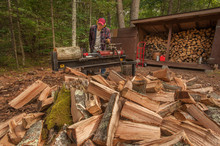 Older Man Using Log Splitter N...