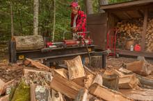 Older Man Using Log Splitter N...