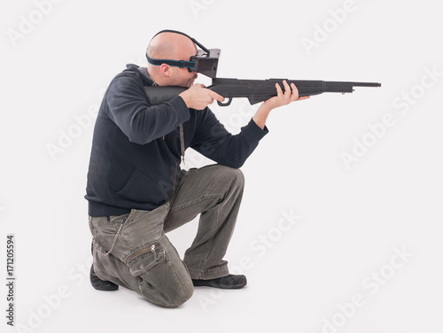 Man play VR shooter game with vr rifle and glasses - Buy