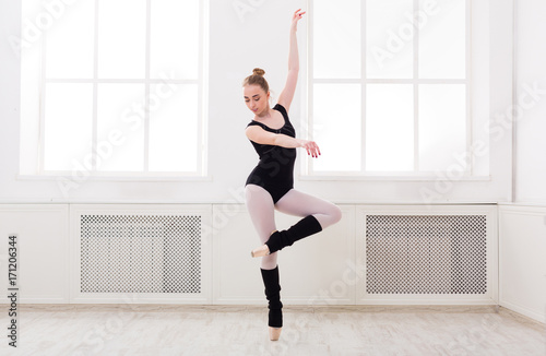 Beautiful ballerina stands in ballet pirouette Tapéta, Fotótapéta