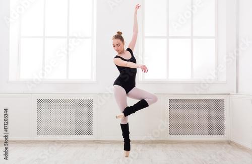 Beautiful ballerina stands in ballet pirouette Fototapeta