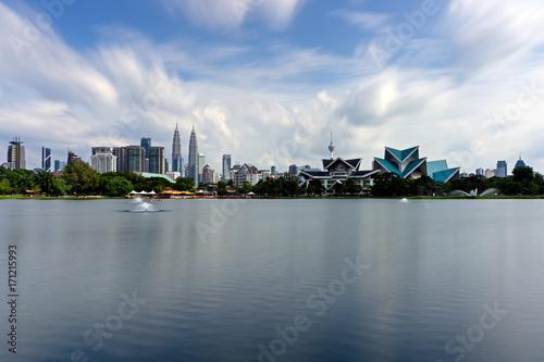 Obraz na plátne  Long exposure of Kuala Lumpur skyline as seen from Taman Tasik Titiwangsa also known as Titiwangsa Lake Garden located in Kuala Lumpur, Malaysia