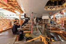 Male Aircraft Maintenance Engineer Working Over An Aircraft