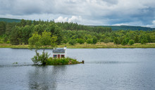 The Wee Hoose, A Small House Built In Loch Shin, Near Lairg In The Scottish North West Highlands.
