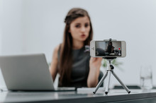 Woman Vlogger Recording Business Vlog At Office Desk