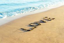 Love Word On Beach Sand
