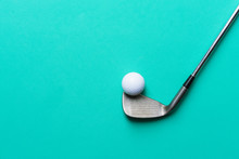 Golf Ball And Golf Club On Gre...