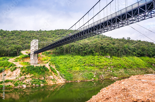 Fotografia, Obraz  Beautiful Suspension Bridge in Mae Kuang dam with tourists enjoying the view, Chiang Mai, Thailand