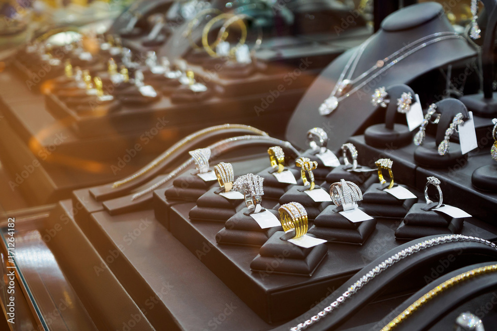 Fototapeta Gold jewelry diamond shop with rings and necklaces luxury retail store window display showcase