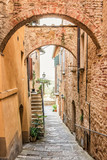 Fototapeta Uliczki - Beautiful narrow street in Montepulciano in Tuscany Italy. Montpulciano is famous for its wine.