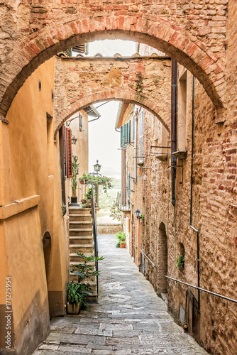 Beautiful narrow street in Montepulciano in Tuscany Italy. Montpulciano is famous for its wine. © Delphotostock